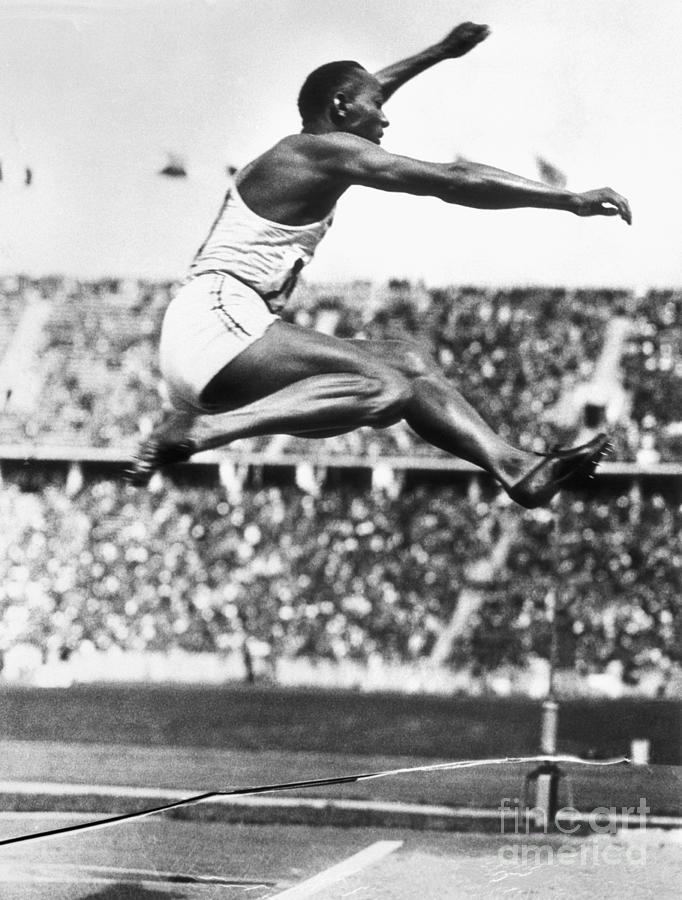 Jesse Owens In Midair Photograph by Bettmann