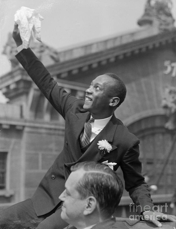 Jesse Owens Waving During Parade Photograph by Bettmann