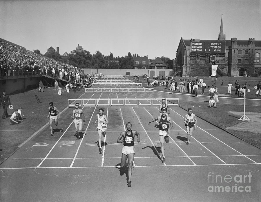 Jesse Owens Winning Hurdles Photograph by Bettmann
