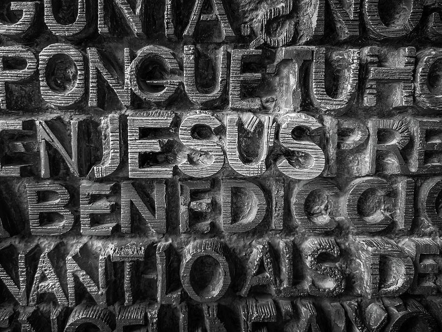 Antoni Gaudi Photograph - Jesus Written In Metallic Letters. by Art Spectrum