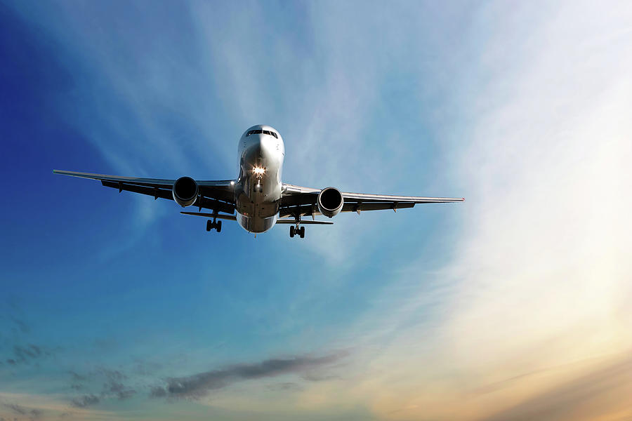 Jet Airplane Landing At Dusk Photograph by Sharply done