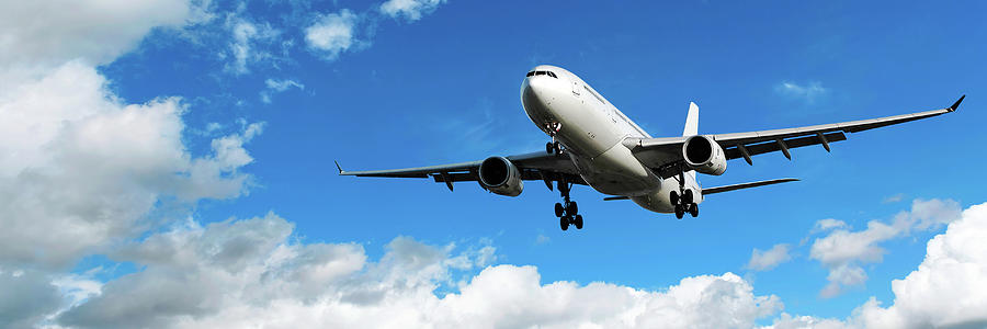 Jet Airplane Landing In Bright Sky Photograph by Sharply done