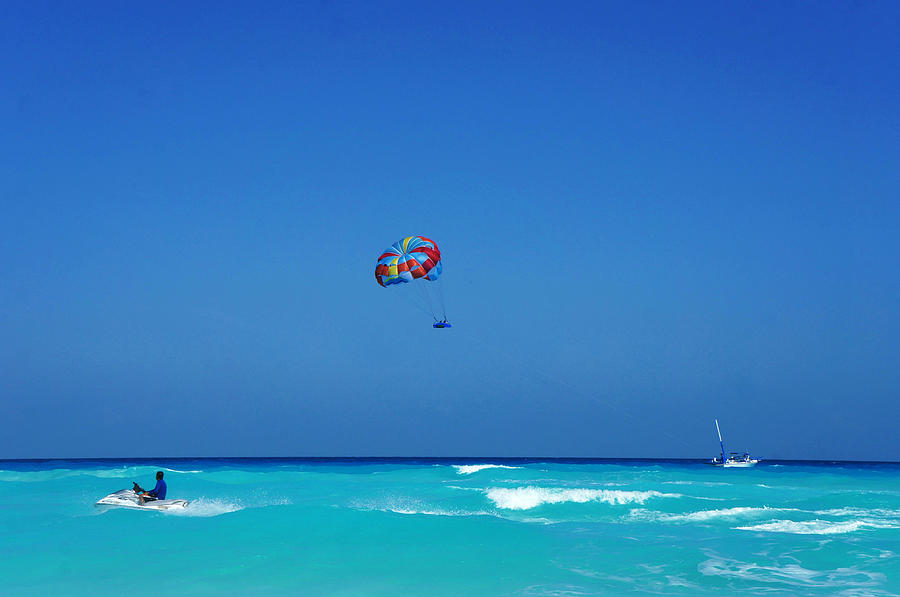 Jet Skiing And Parasailing In The Photograph by Tony Ibarra Photography