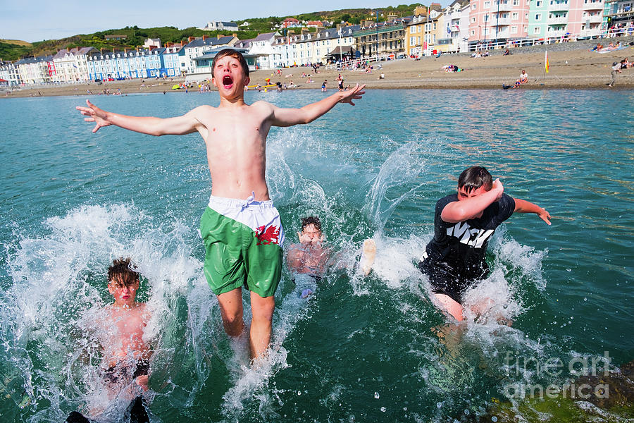 Aberystwyth Photograph - Jetty Jumping Into The Sea by Keith Morris