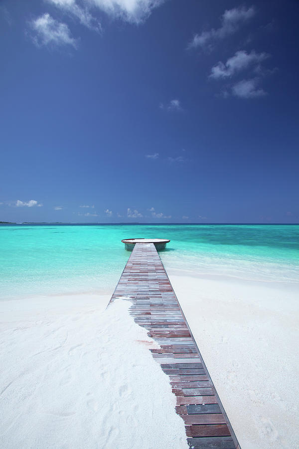 Jetty Leading To Ocean, Maldives Photograph by Sakis Papadopoulos