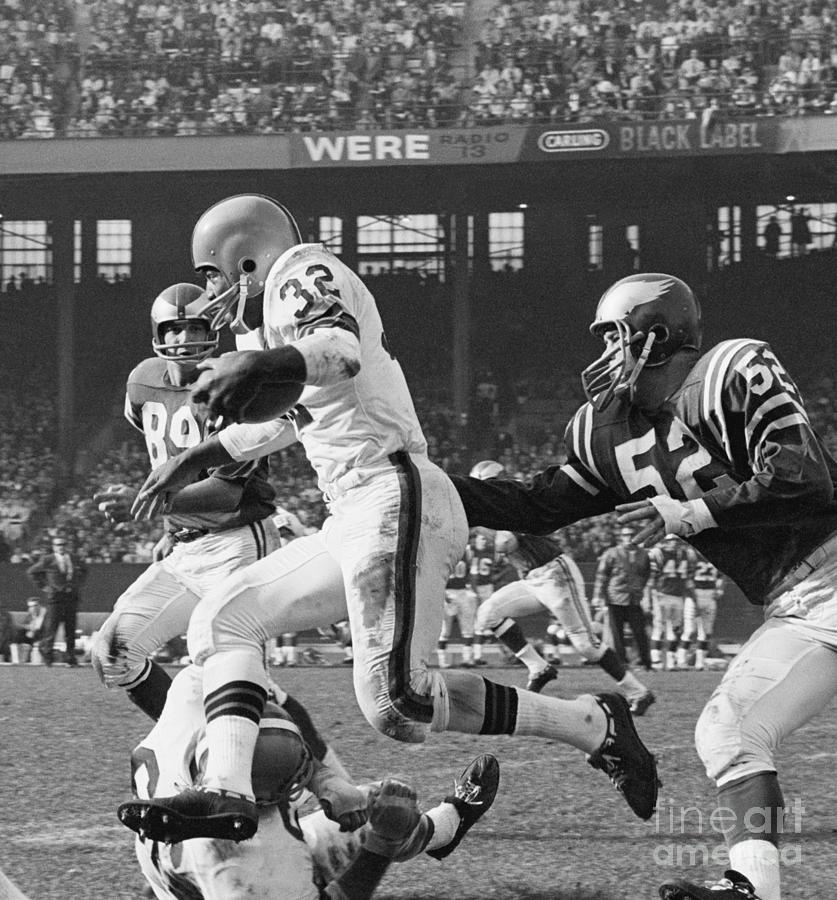 Jim Brown Leaping Over Gene Hickerson Photograph by Bettmann