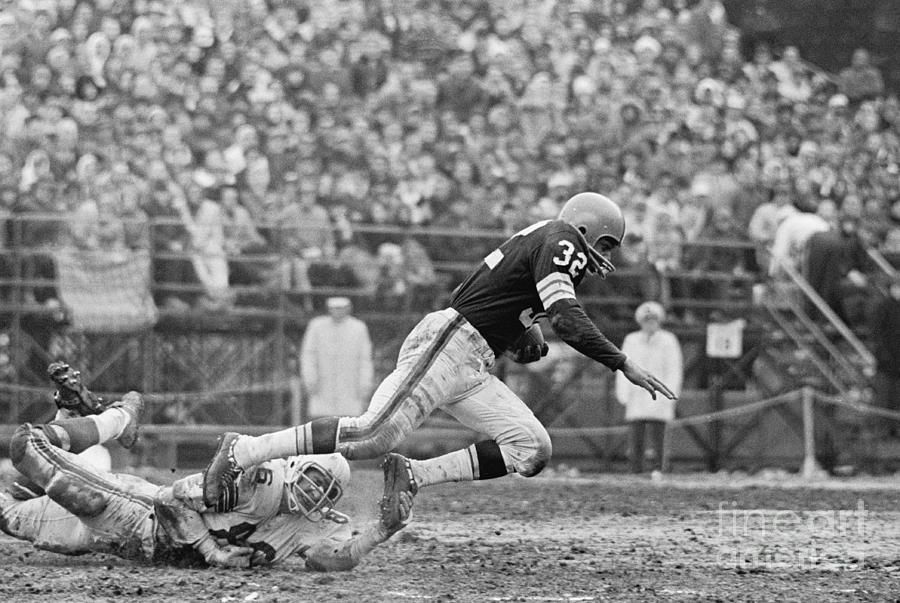 Jim Brown Running With Football Photograph by Bettmann