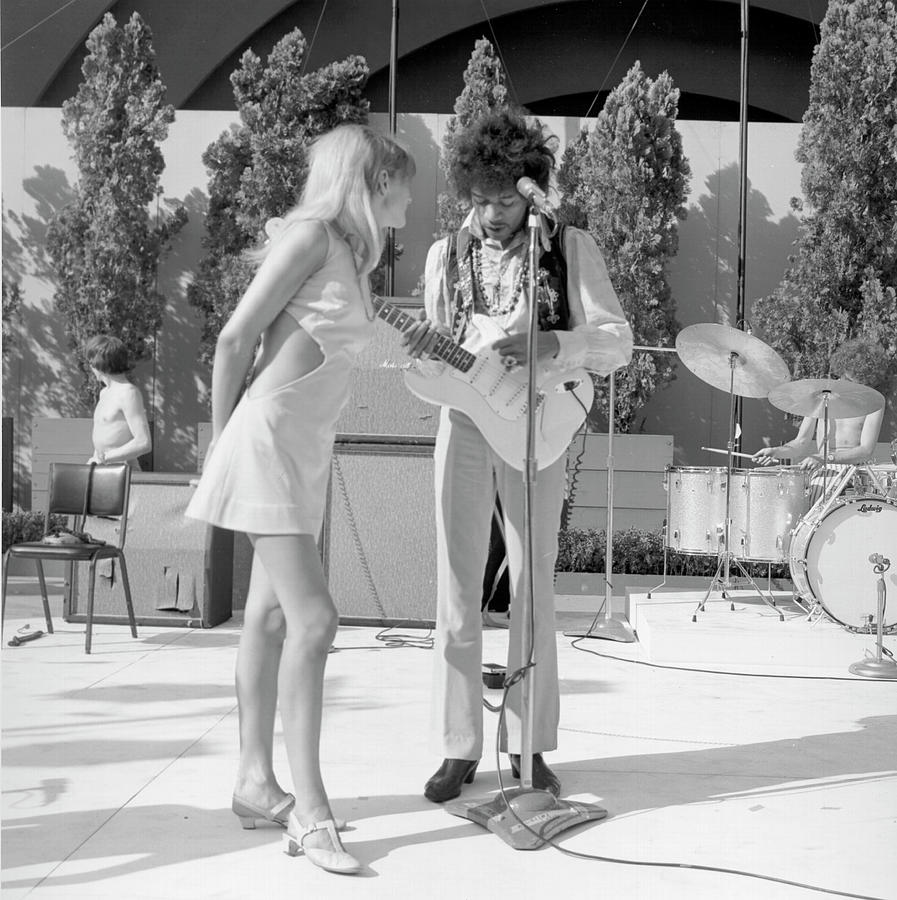 Jimi Hendrix With A Muse Photograph by Michael Ochs Archives