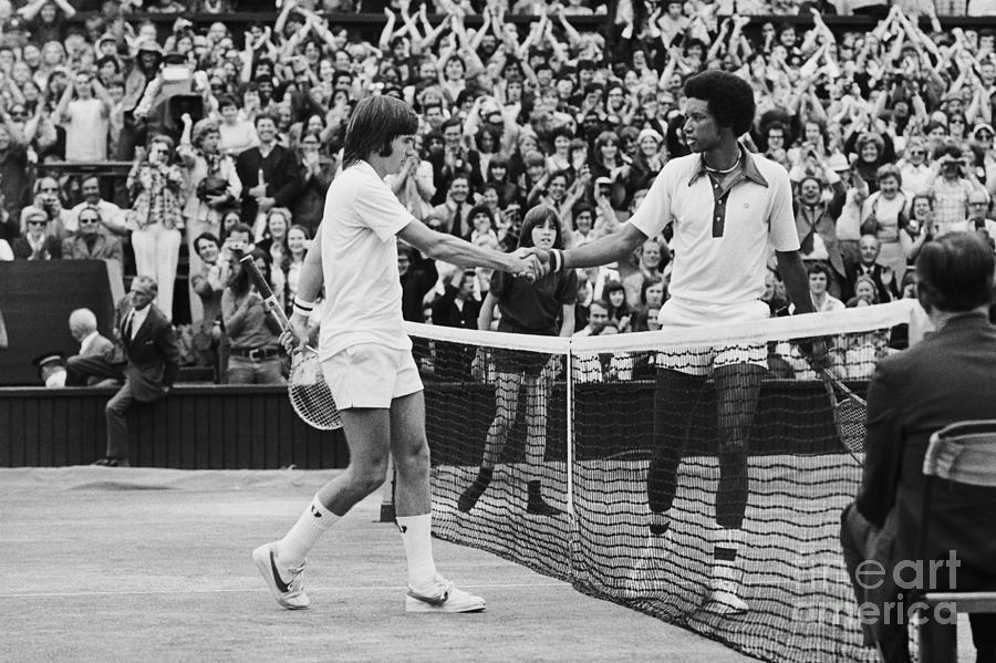 Jimmy Connors And Arthur Ashe Shake Photograph by Bettmann
