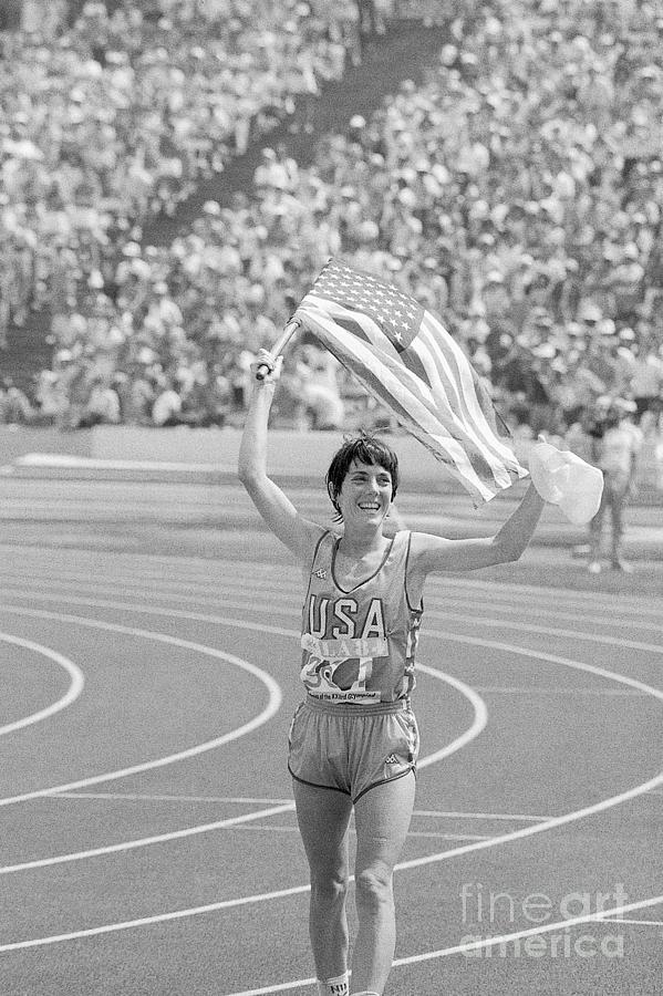 Joan Benoit Running With American Flag Photograph by Bettmann