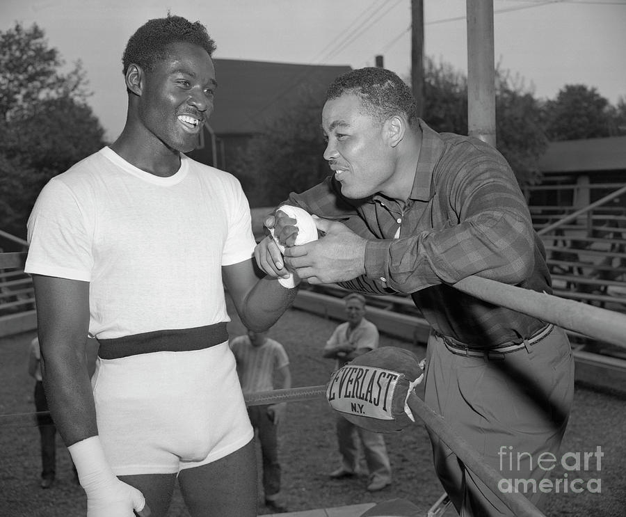Joe Louis And Ezzard Charles Conversing Photograph by Bettmann