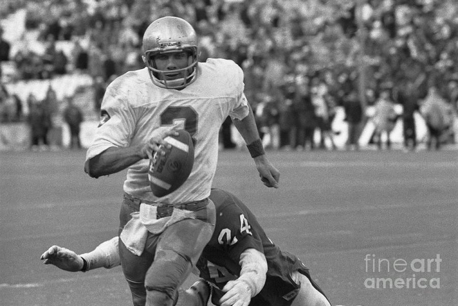 Joe Montana Runs With Football Photograph by Bettmann