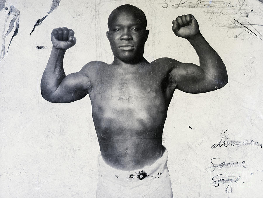 Joe Walcott Flexing Muscles Photograph by Bettmann