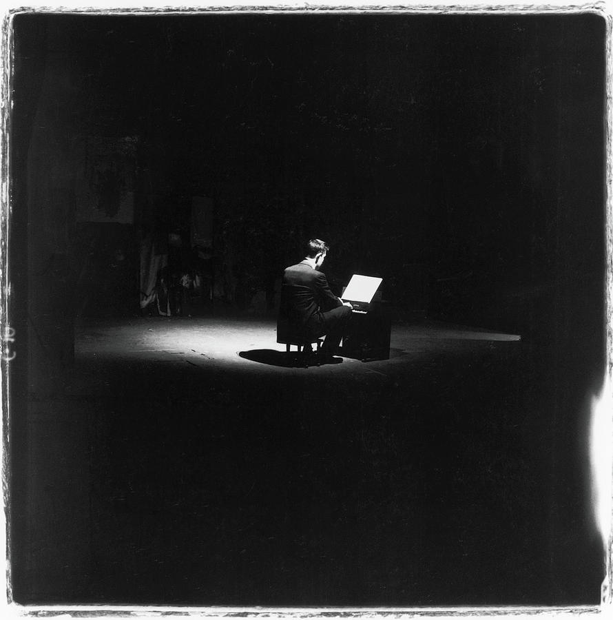 John Cage Performs Photograph by Fred W. McDarrah