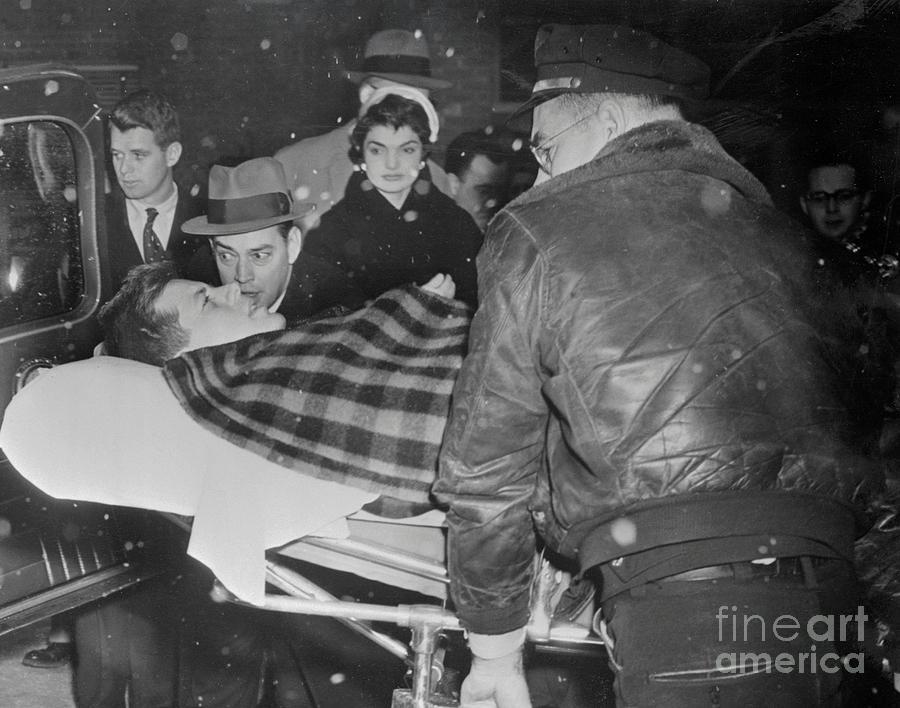 John F. Kennedy Being Transferred Photograph by Bettmann