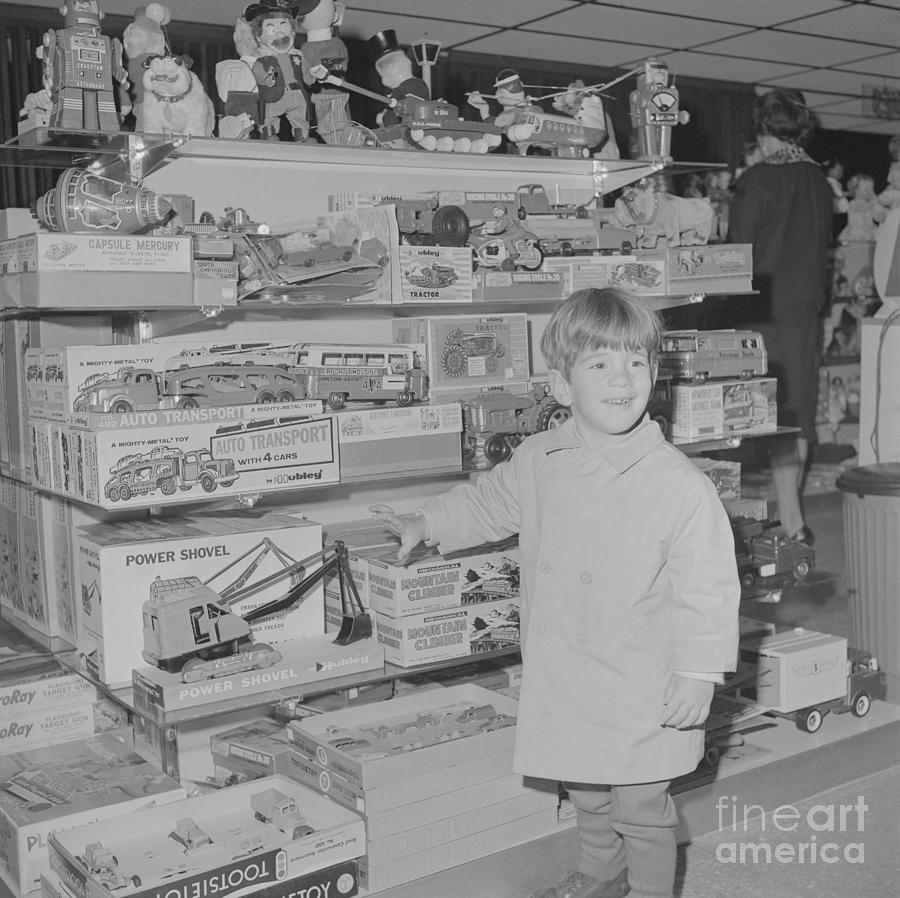 John F. Kennedy Jr. Enjoying Toy Store Photograph by Bettmann