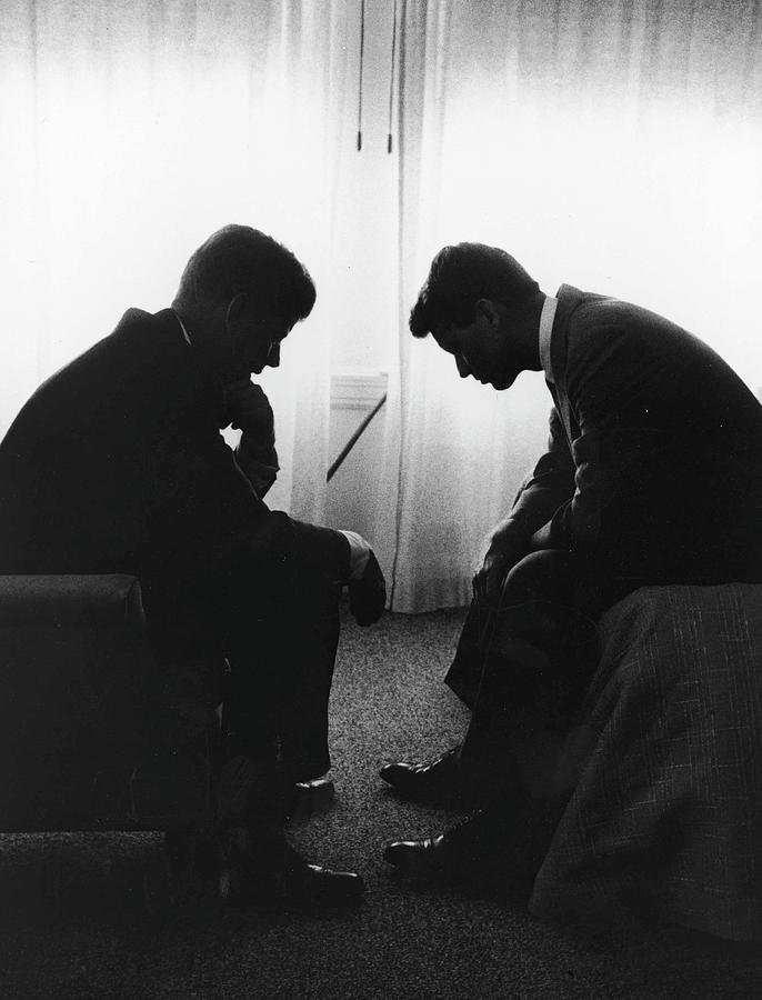 John Kennedy Confers With Robert Kennedy Photograph by Hank Walker
