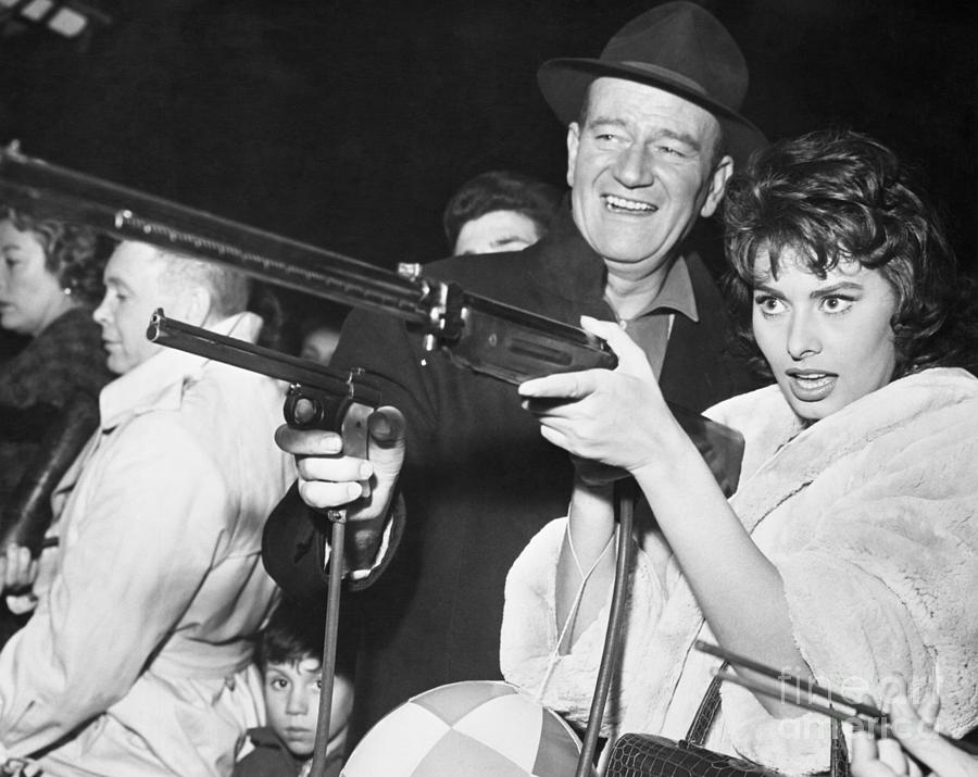 John Wayne And Sophia Loren Gun Play Photograph by Bettmann