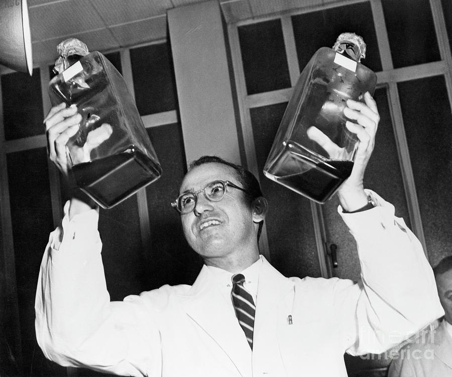 Jonas Salk Holding Bottles Of Polio Photograph by Bettmann