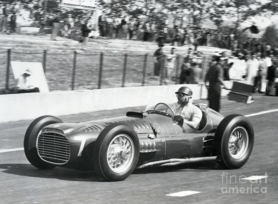 Juan Manuel Fangio Warming Up Race Car Photograph by Bettmann