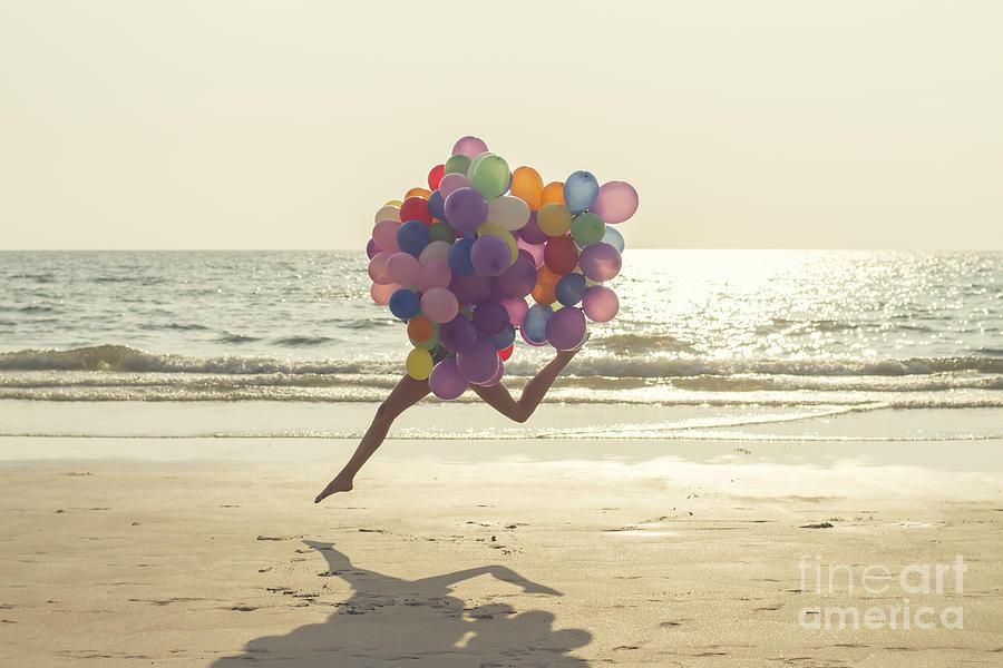 Jumping Girl With Balloons Photograph by Vizerskaya