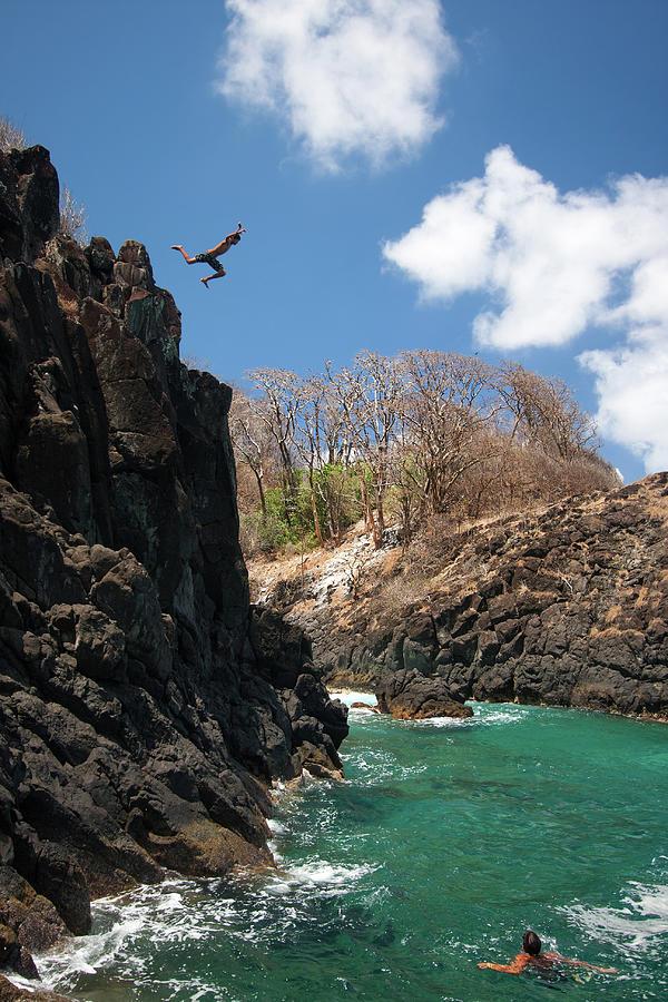 Jumping Photograph by Mauricio M Favero