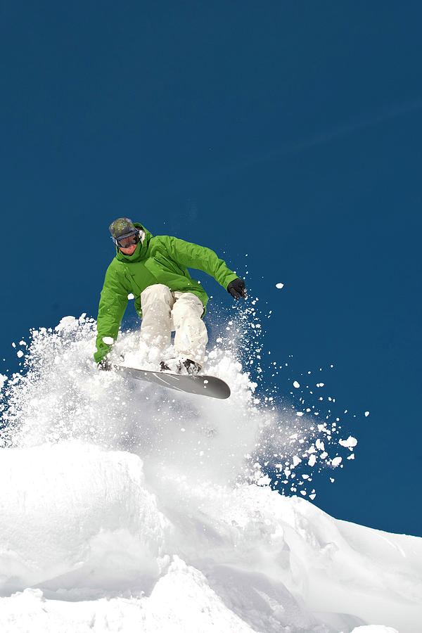 Jumping Snowboarder With Clouds Of Snow Photograph by Jack Affleck