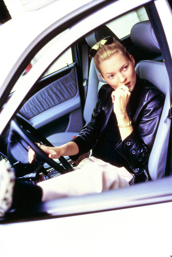 Kate Moss Sits At The Wheel Of A Car Photograph by Arthur Elgort