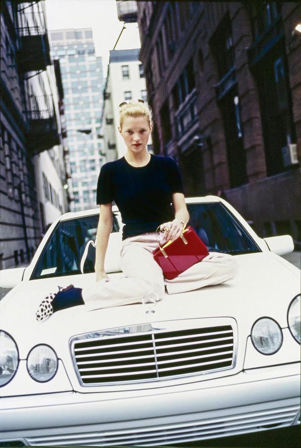 Kate Moss Sits On A Mercedes-benz Sl500 Photograph by Arthur Elgort