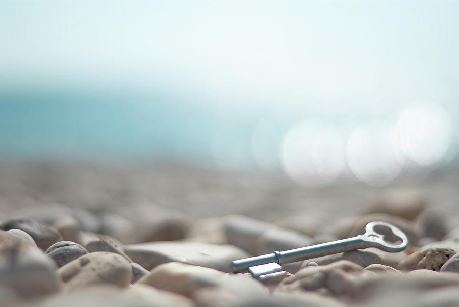 Key On Pebbles Photograph by Alexandre Fp