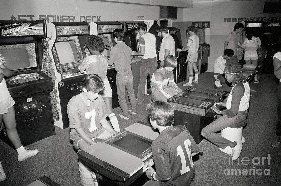 Kids In A Video Game Arcade Photograph by Bettmann