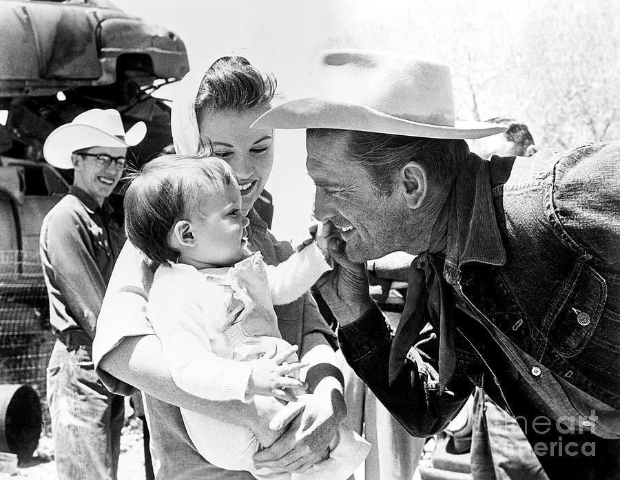 Kirk Douglas With Infant Photograph by Bettmann