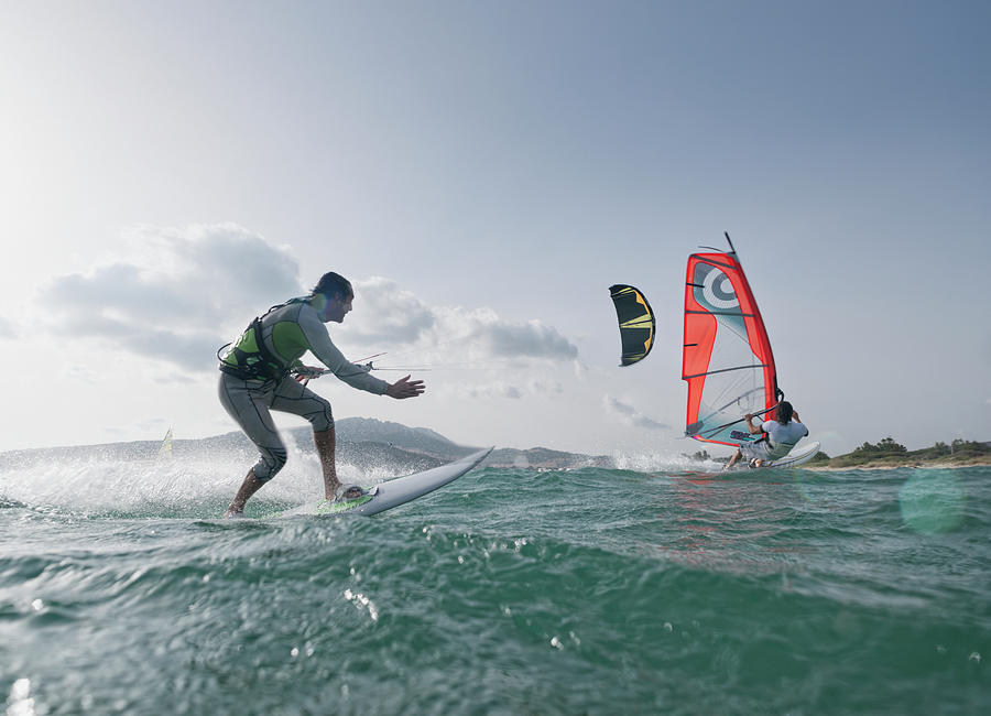 Kitesurfer And Windsurfer Along The Photograph by Ben Welsh / Design Pics