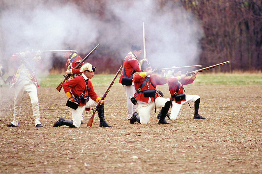 Kneeling Redcoats Firing, Revolutionary War Reenactment, Patriot's Day  2002, Concord, Massachusetts by Ross Warner