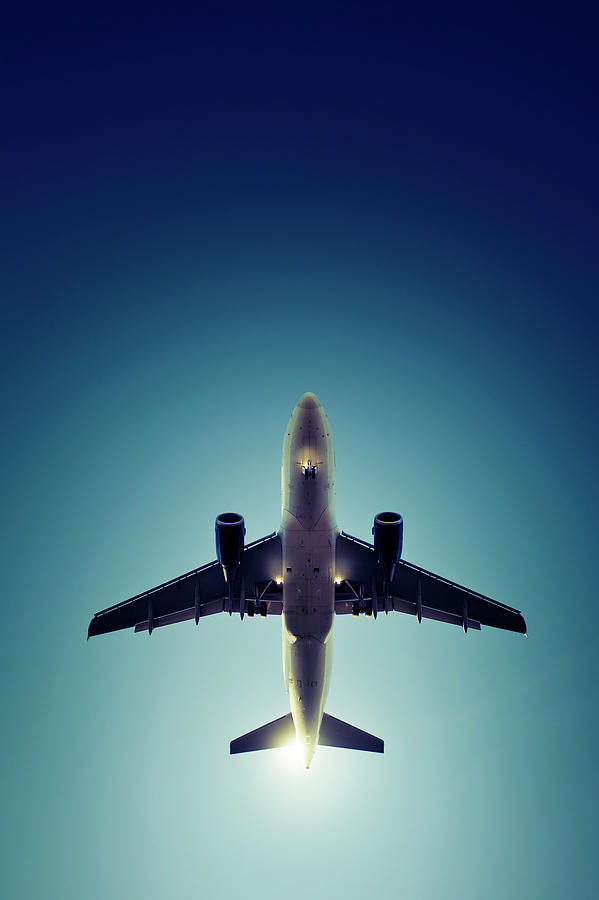 Landing Airplane At Dusk Photograph by Ollo