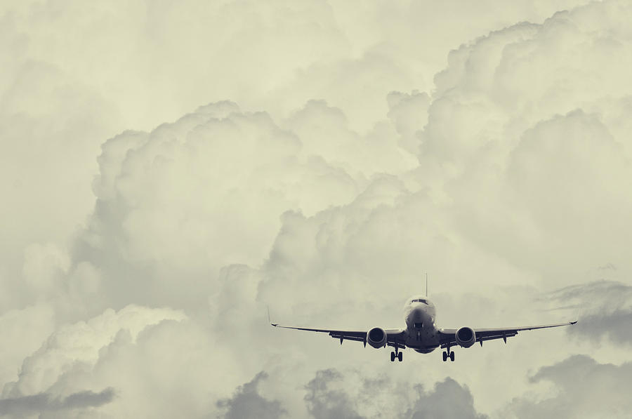 Landing In Cumulous Photograph by Shaunl