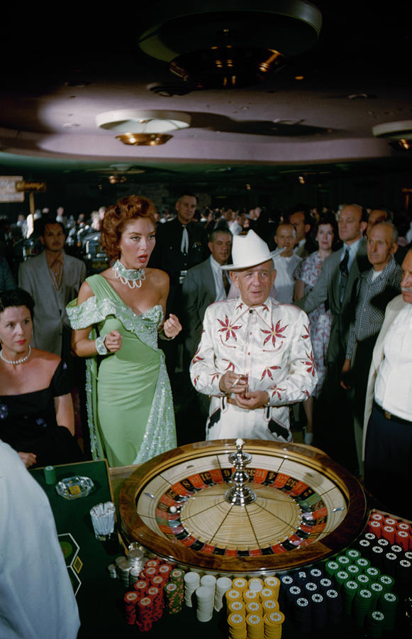 Las Vegas - Customers Rolling Dice At Photograph by Loomis Dean