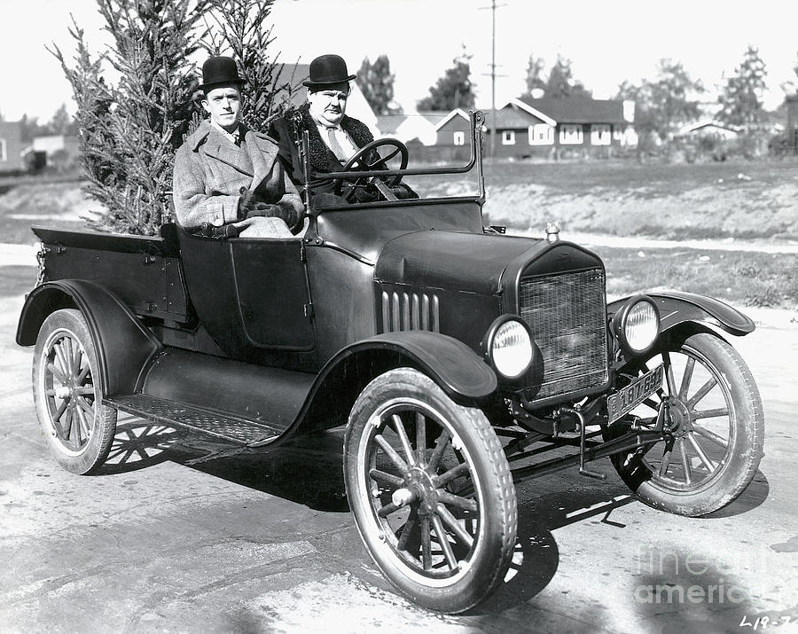 Laurel And Hardy In A Model T Ford Photograph by Bettmann
