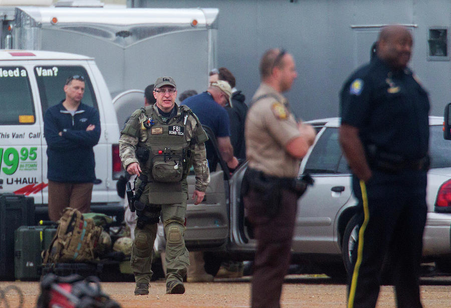 Law Enforcement Walk To The Hostage Photograph by Mark Wallheiser