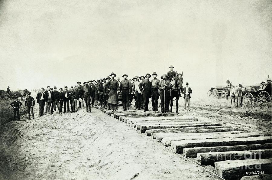 Laying Down Railroad Tracks Photograph by Bettmann