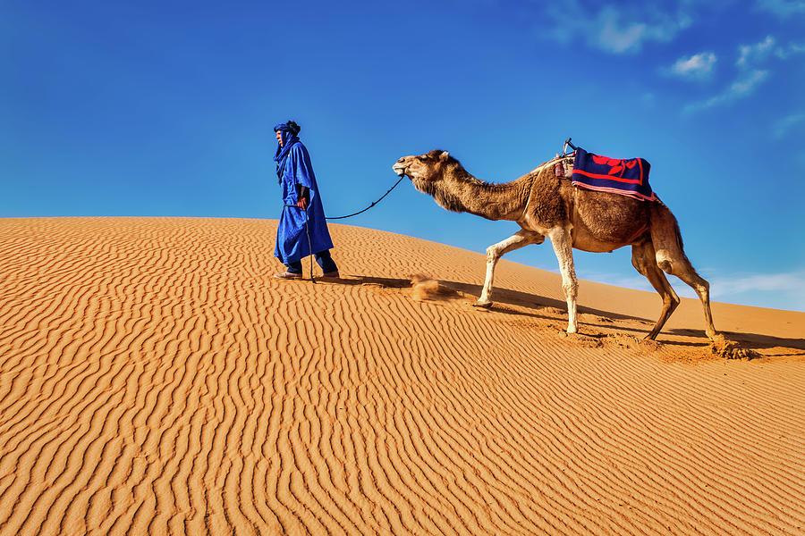 Leading a Camel - Morocco by Stuart Litoff