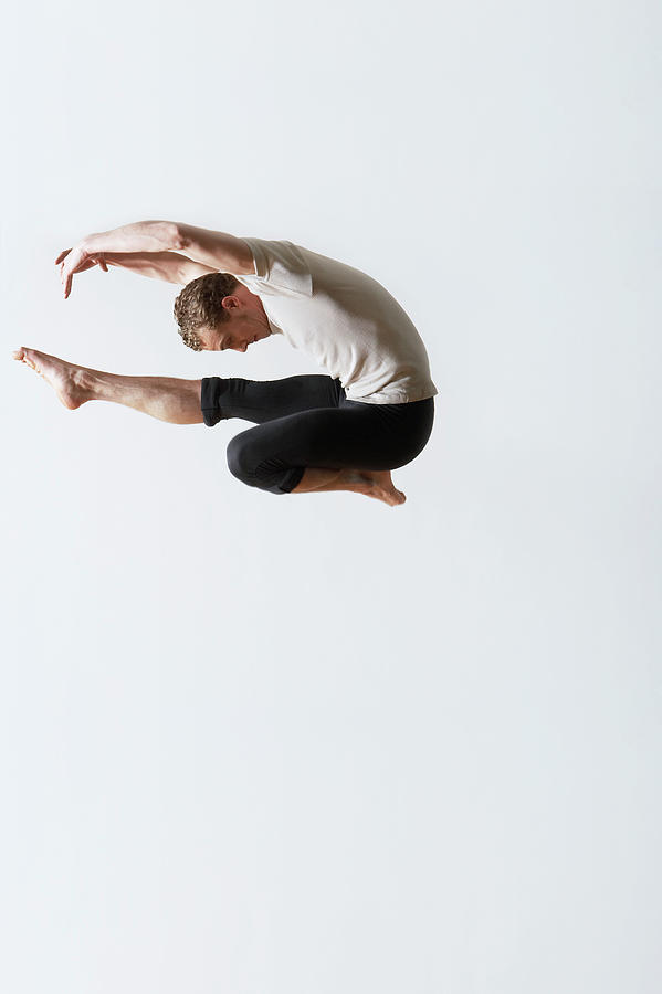 Leaping Ballet Dancer In Mid-air Photograph by Moodboard