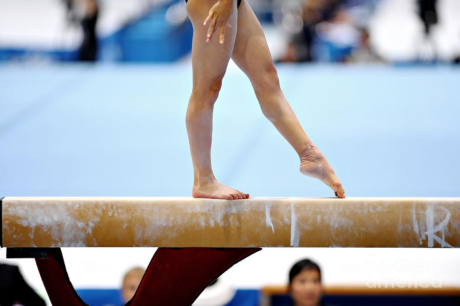 Gymnast Photograph - Legs Of A Gymnast Are Seen During An by Roibu