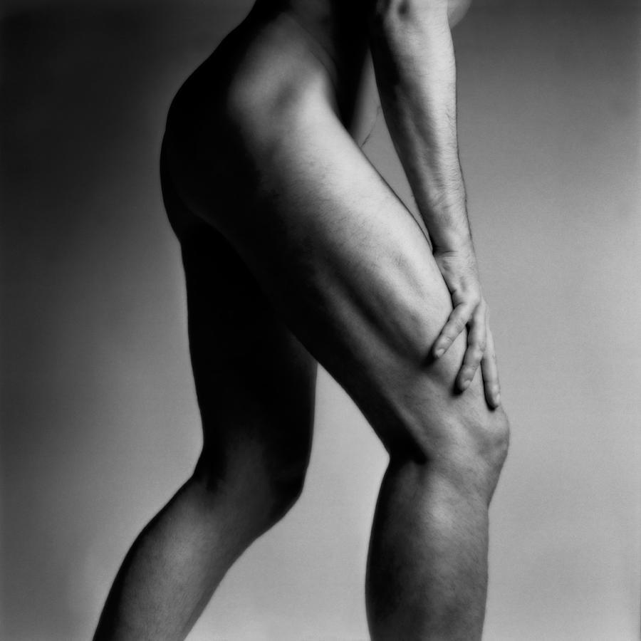 Legs Of Nude Man Photograph by Bernard Jaubert