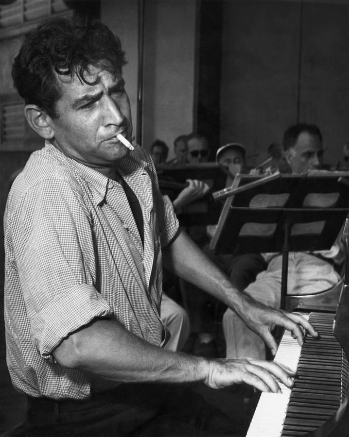 Leonard Bernstein Smoking At Piano Photograph by Bettmann