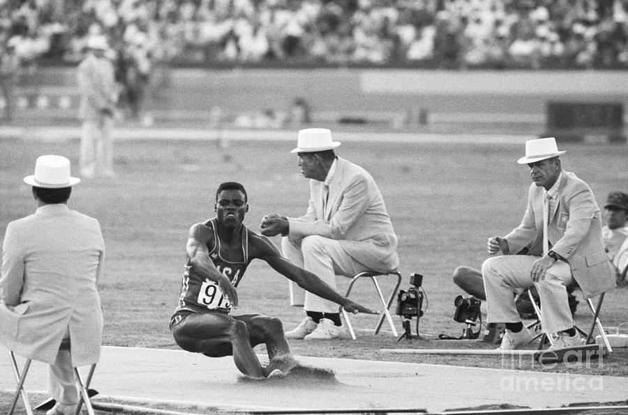 Lewis In The Long Jump At Olympics Photograph by Bettmann