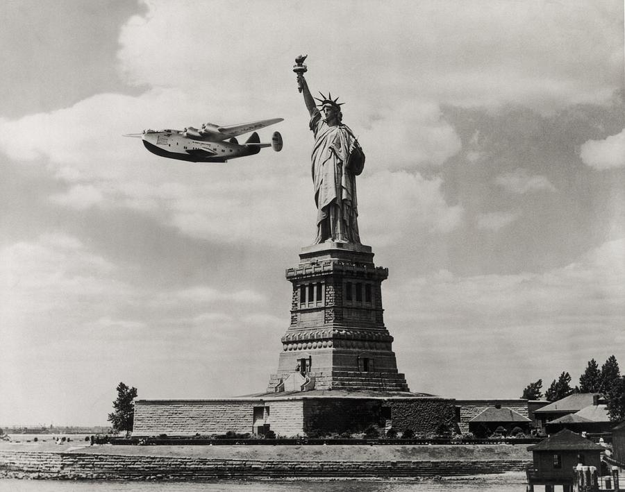Liberty And Plane Photograph by Edwin Levick