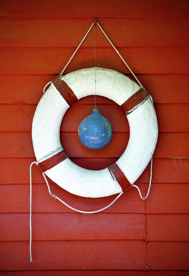 Life Buoy Hanging On Wall Photograph by The Rich Earthy Tones Of Terracotta