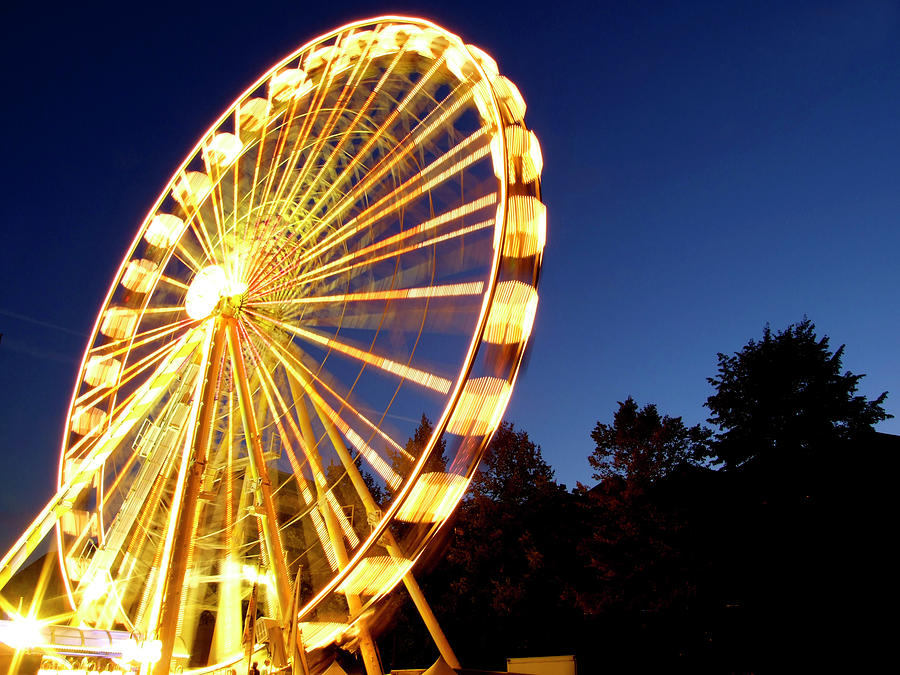 Lighted Ferris Wheel Spinning In Motion Photograph by Vfka