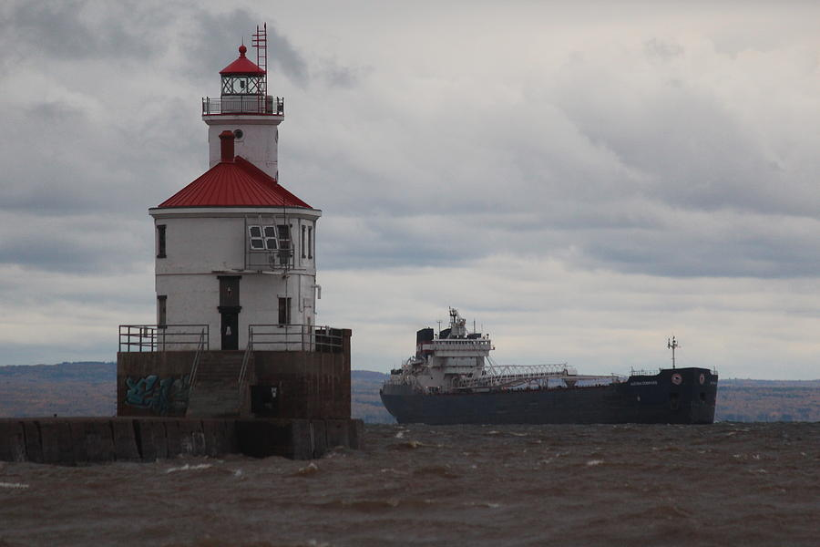 Lighthouse Photograph - Lighthouse And Passing Ship by Callen Harty